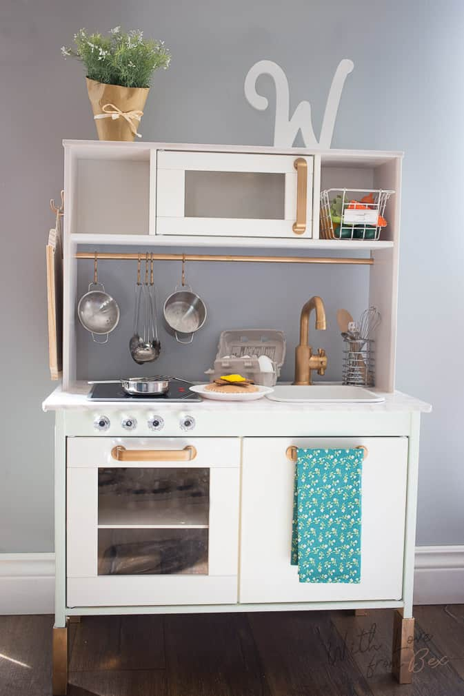 duktig ikea play kitchen hack customized with pale green paint and gold spray paint - Ikea Play Kitchen